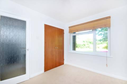 <b>Second Bedroom</b><span class='dims'> 11'1 x 9'11 (3.38 x 3.02m)</span>